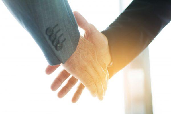 handshake with 2 men in suits