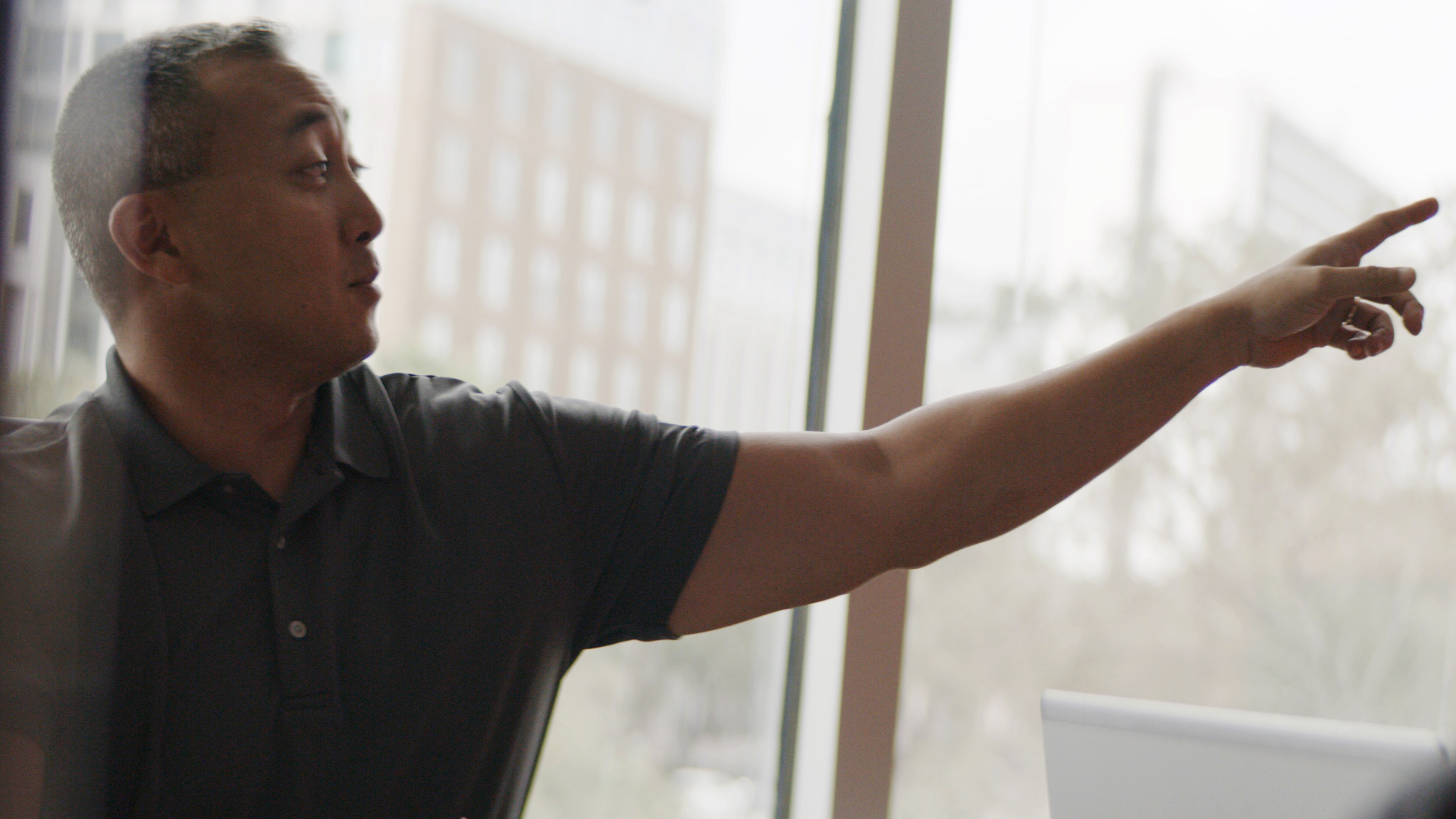 man pointing in office